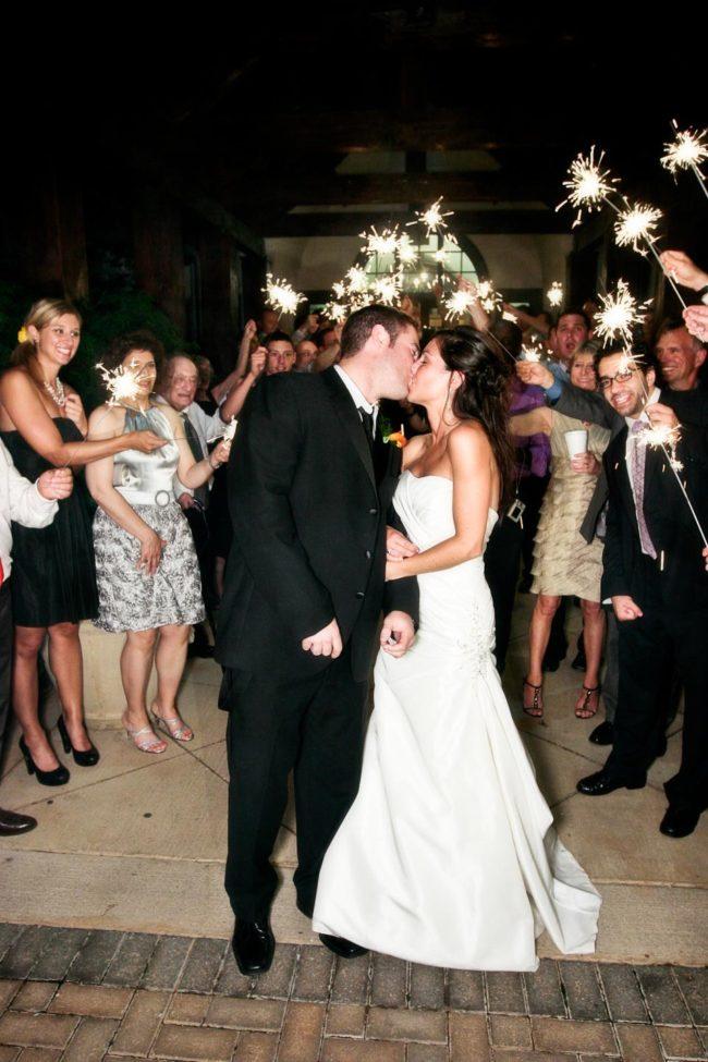 Wedding sparkler kiss.