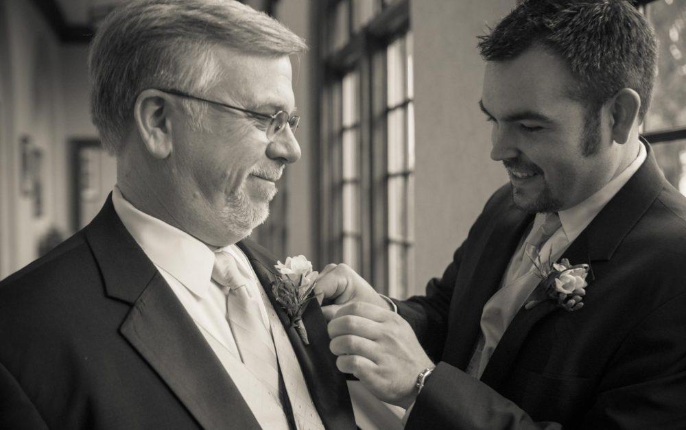 pinning corsage at wedding