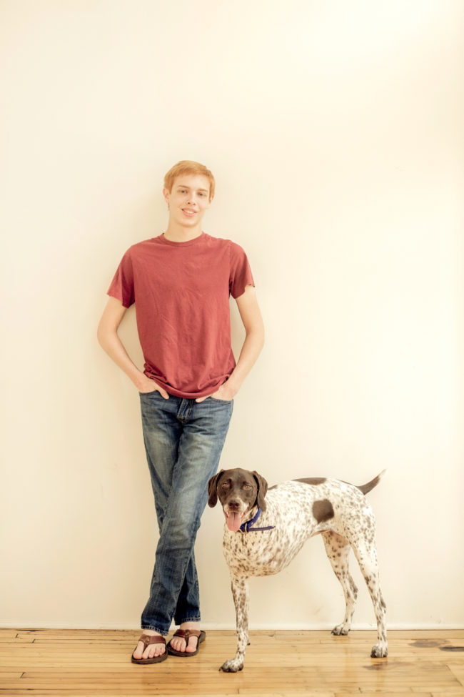 high school senior boy and his dog